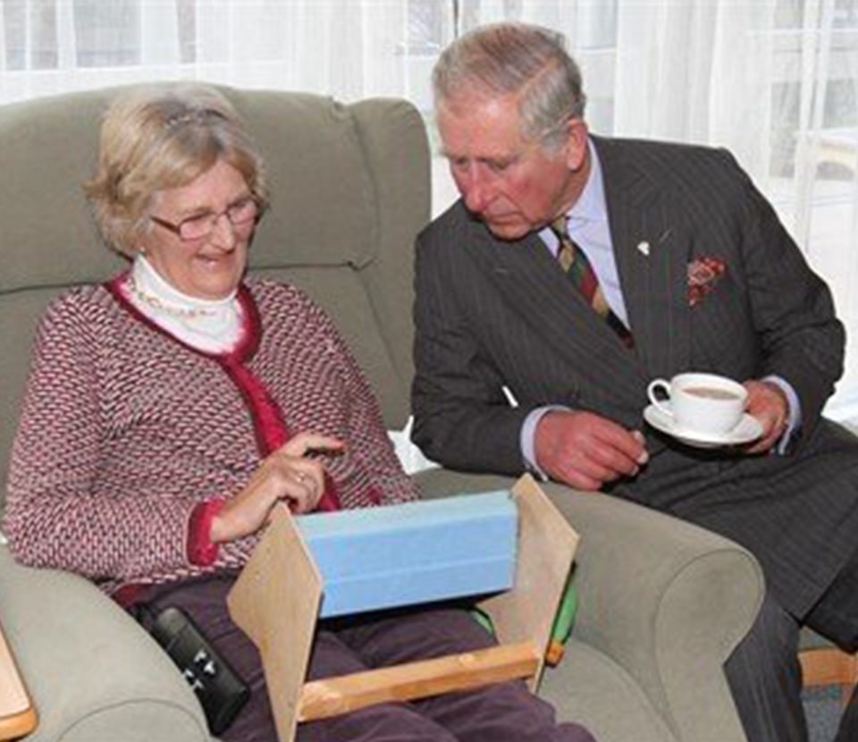 Prince Charles seated visiting Longfield
