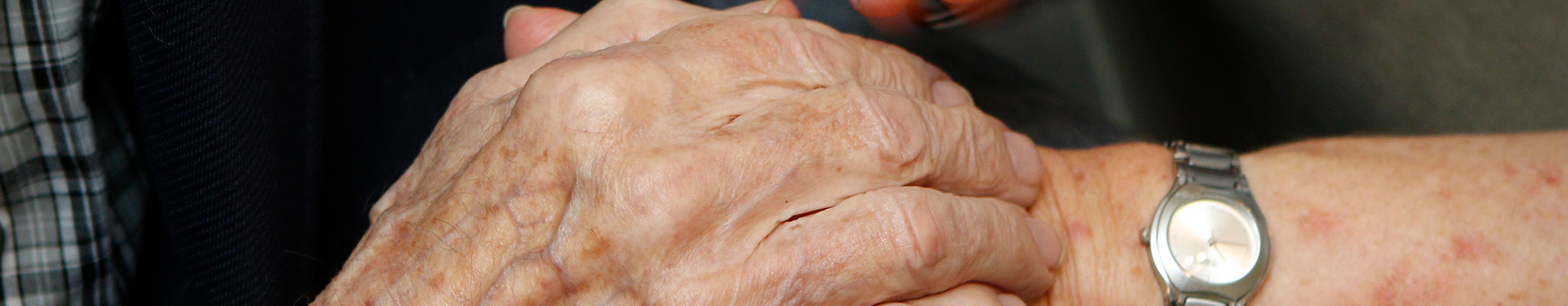 Close up of clasped hands