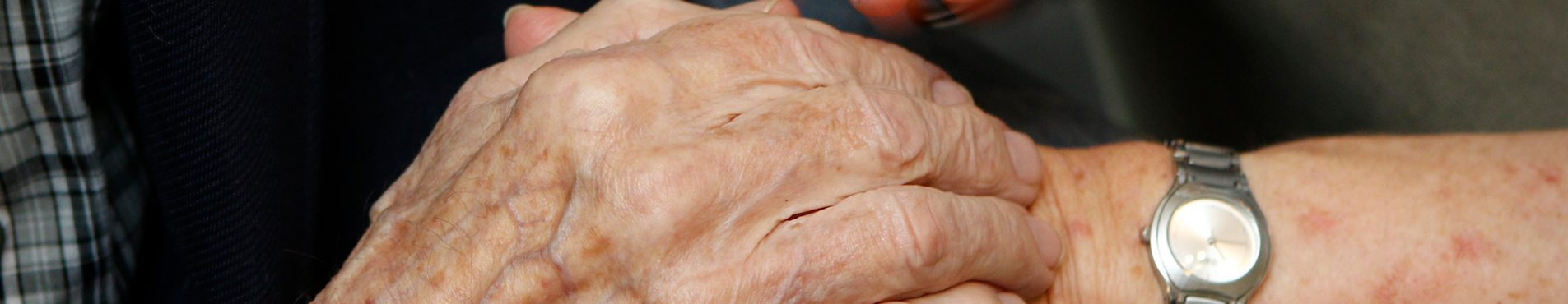 banner image of clasped hands