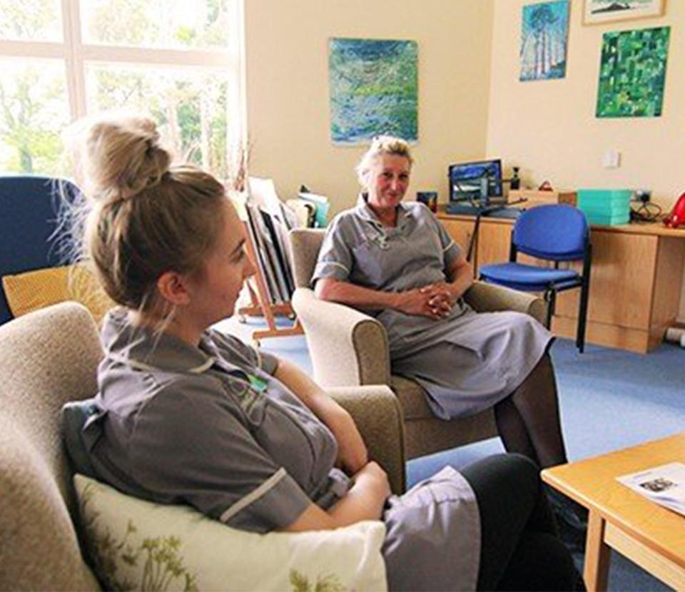 Two Longfield nurses sat talking
