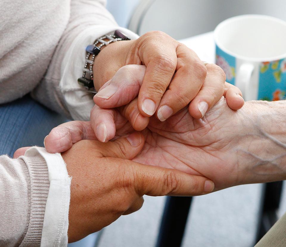 Hands being held