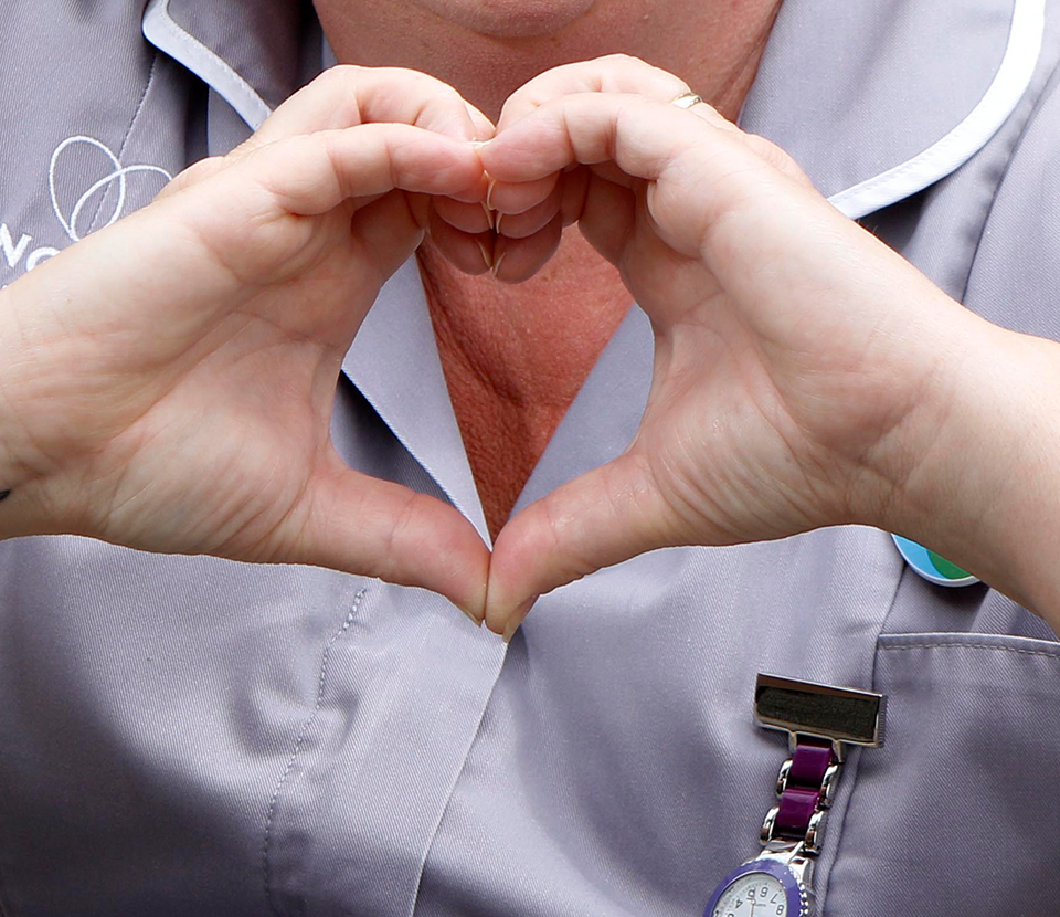 Nurse forming a heart with her hands