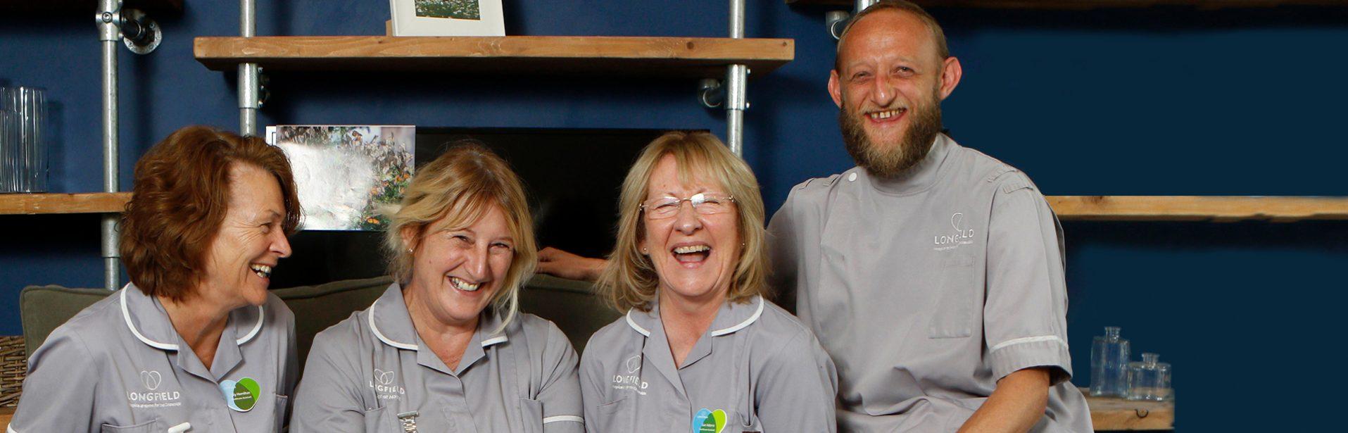 Team of Longfield staff sat laughing