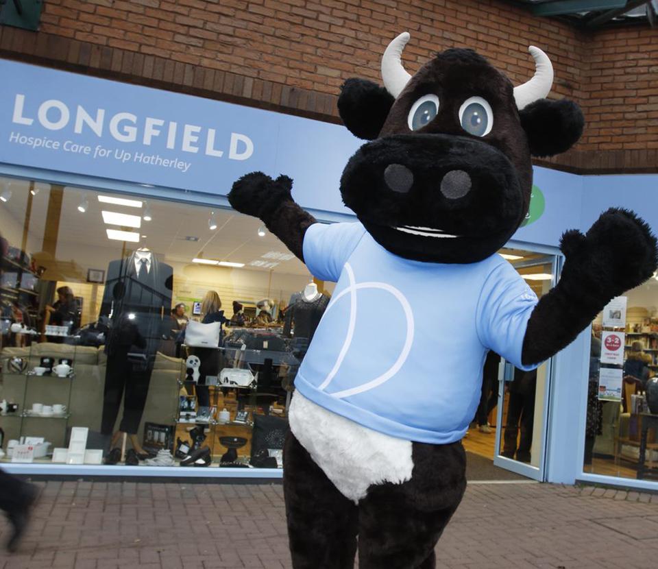 Longfield mascot outside the Up Hatherley shop