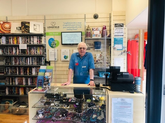 Longfield shop volunteer behind the till